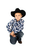 Young Cowboy. Wearing a hat against white royalty free stock photos