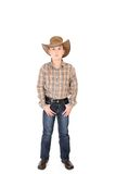 Young cowboy. A young cowboy standing with feet apart on a white background royalty free stock images