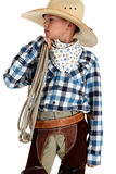 Young cowboy in big hat holding a rope. Young cowboy in big hat holding rope royalty free stock photo