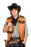 Young cowboy with a bottle Royalty Free Stock Images