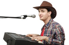 Young cowboy creates western music Royalty Free Stock Photo