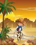 A young cowboy at the desert. Illustration of a young cowboy at the desert Stock Images