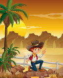 A young cowboy at the desert near the rocks. Illustration of a young cowboy at the desert near the rocks Stock Image
