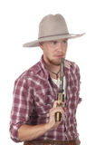 Young cowboy with drawn pistol. Young cowboy with drawn single-action revolver Royalty Free Stock Photos