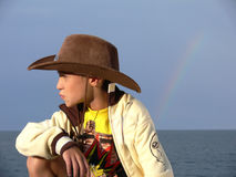 Young cowboy dreaming Royalty Free Stock Image
