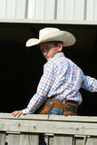 Young cowboy on fence Stock Photography