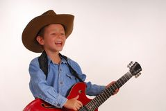 Young cowboy with guitar Royalty Free Stock Photo