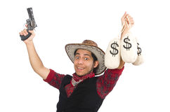 Young cowboy with gun and money bags isolated on Royalty Free Stock Photos