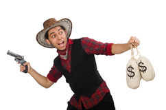 Young cowboy with gun and money bags isolated on Stock Photo