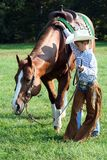 Young cowboy and horse Royalty Free Stock Image