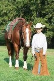 Young cowboy and horse Royalty Free Stock Photos