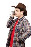 Young cowboy listening romantic country music Royalty Free Stock Photo