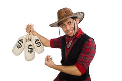 Young cowboy with money bags isolated on white Stock Photo