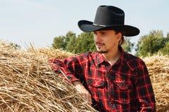 Young cowboy near a haystack Stock Photos