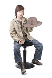 Young cowboy playing with the hat Royalty Free Stock Image