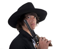 Young cowboy with revolver. And black hat Royalty Free Stock Photo