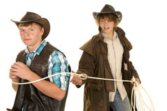 Young cowboy ropes another cowboy Royalty Free Stock Photos