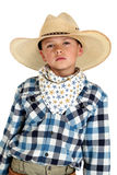 Young cowboy with a serious look wearing a large h Stock Images