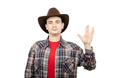 Young cowboy showing Vulcan salute Royalty Free Stock Images