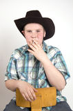 Young  cowboy smoking a cigaret Royalty Free Stock Photo