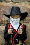 Young cowboy with toy guns. Young cowboy playing with toy guns, looking into camera with serious look in his eyes Stock Photos