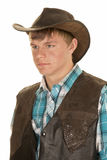 Young cowboy in vest look side close Stock Photography