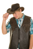 Young cowboy in vest touch hat look down Stock Photos