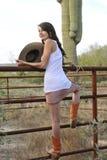 Young Cowgirl Climbing Fence Stock Photos