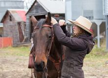 Young Cowgirl Getting Ready For A Horse Ride Stock Photography