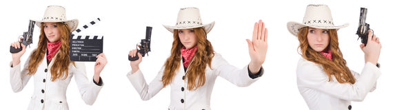 The young   cowgirl with gun  and movie board  isolated on white Royalty Free Stock Images