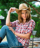 Young cowgirl in hat Stock Photo