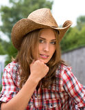 Young cowgirl in hat Stock Photos