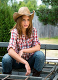 Young cowgirl in hat Stock Images