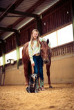 Young Cowgirl With Her Horse And Dog Stock Photos