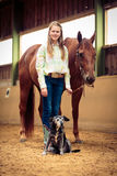 Young Cowgirl With Her Horse And Dog. On horse ranch Royalty Free Stock Images