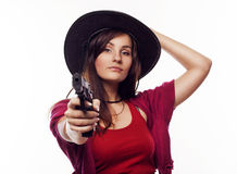 Young cowgirl holding gun Stock Image