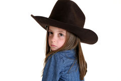 Young cowgirl looking over her shoulder with a somber look Stock Images