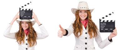 The young   cowgirl  with movie board isolated on white Stock Photography