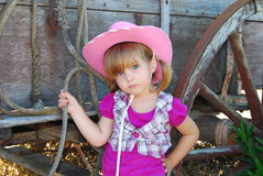 Young cowgirl next to wagon Stock Photo