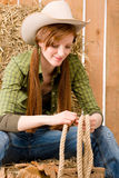 Young cowgirl western country style with rope Royalty Free Stock Image