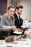 Young coworkers eating at the business lunch Royalty Free Stock Photos