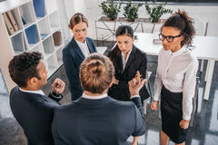 Young coworkers in formalwear arguing at business meeting in office. Business team meeting Royalty Free Stock Photo