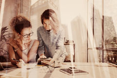 Free Young Coworkers Working In Modern Loft.Two Girls Using Electronic Tablet On Workplace.Double Exposure,skyscraper Office Royalty Free Stock Photography - 96274497