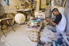 Young craftsman makes tiles for a mosaic, Tangier, Morocco Royalty Free Stock Image