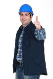 Young craftsman thumb up Royalty Free Stock Photo