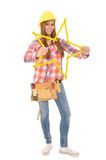 Young craftswoman tinkering yellow star. Young craftswoman tinkreing a star from a yellow ruler Stock Photography