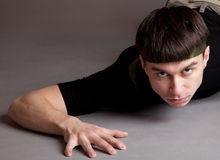 Young crawling man Stock Photos