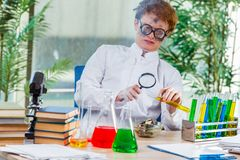 The young crazy chemist working in the lab Stock Image