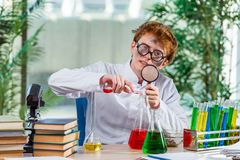 The young crazy chemist working in the lab Stock Photo
