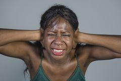 Young crazy desperate and anxious black african American woman feeling stressed and tormented in intense and dramatic face express. Ion isolated on studio royalty free stock image